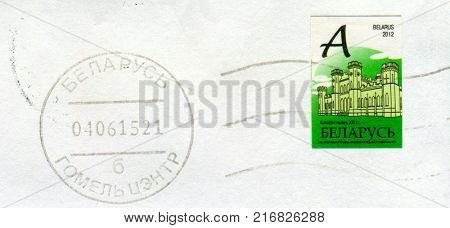 GOMEL, BELARUS, 30 NOVEMBER 2017, Stamp printed in Belarus shows image of the Kosava Castle is a ruined castellated palace in Gothic Revival style, circa 2012.