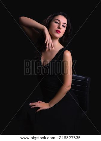 Stunning black haired model posing in vintage style like a hollywood actress