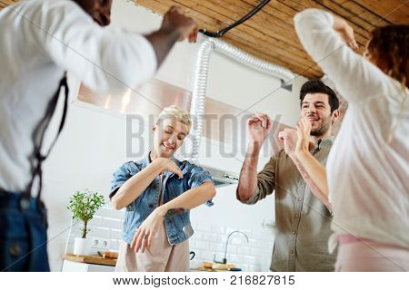 Two guys and their girlfriends dancing in circle at leisure