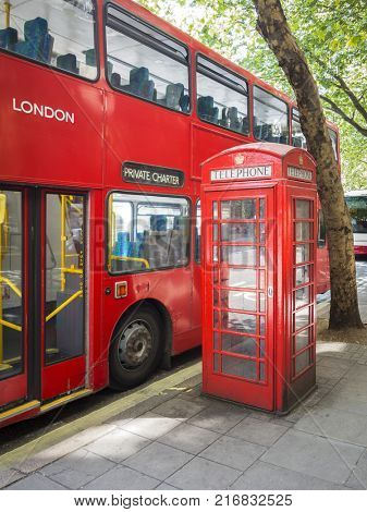 An image of a red bus and typical phone box of London