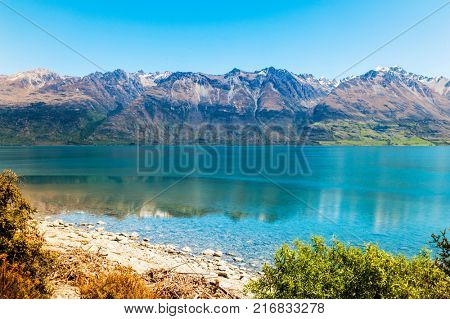 Beautiful lake Wakatipu with mighty mountains reflecting in water at Glenorchy. Otago region, New Zealand