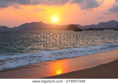 Sunset, mountains, ocean waves and beach, Acapulco de Juarez, Mexico, the Pacific Ocean, North America