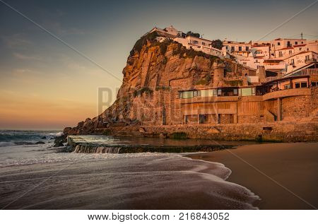 View of beautiful town of Azenhas do Mar in Portugal at sunset light