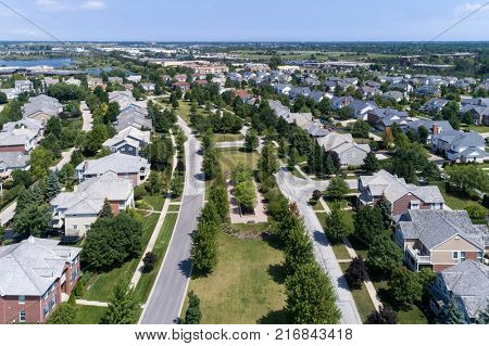 Aerial view of a neighborhood in suburban Chicago with homes on either side of a parkway. poster