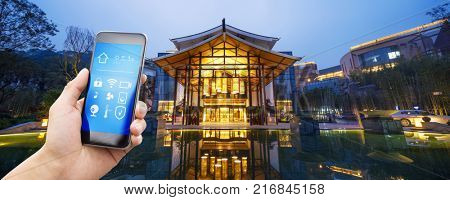 smart phone with smart home and modern business  hotel