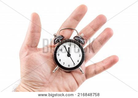 Man Hand Holding Alarm Clock In Palm. Isolated On White. Time Concept.