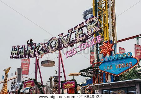 LONDON, UK - NOVEMBER 18, 2017: The Hangover drop-tower at Winter Wonderland, annual Christmas Fair in London, UK. The Hangover is the tallest transportable drop-tower in the world.