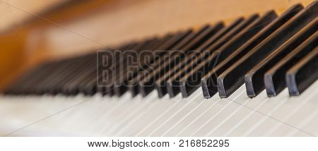 Close-up with very low depth of field and an interesting perspective of a piano keys.