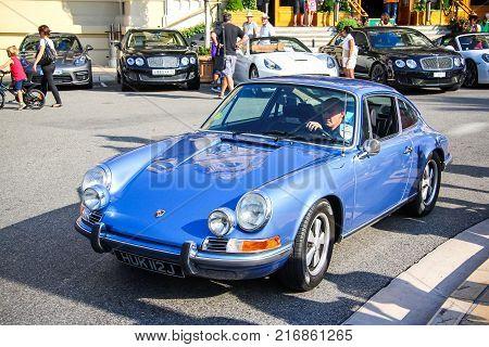 Monte Carlo Monaco - August 2 2014: Cyan classic car Porsche 911 in the city street.