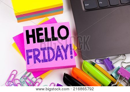 Writing text showing Friday made in the office with surroundings such as laptop, marker, pen. Business concept for Friday - happy end of the week Workshop white background space