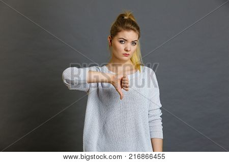 Fashionable outfit ideas trendy clothes concept. Attractive blonde woman wearing tight dark green khaki dress poster