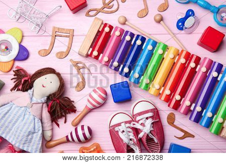 Beautiful composition with xylophone on wooden background. Baby songs concept