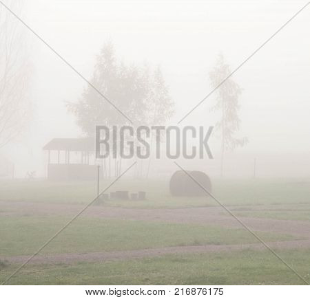 pergolas in recreation early in the morning in the dense fog