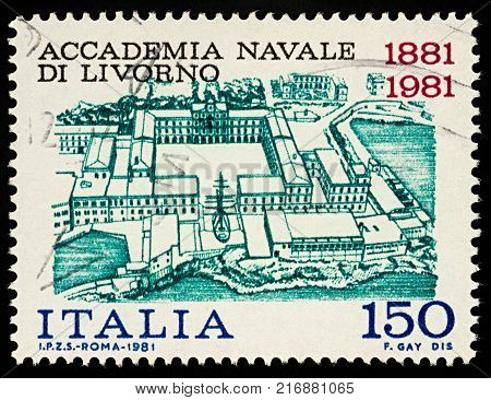 Moscow Russia - December 04 2017: A stamp printed in Italy shows upper view of Naval Academy in Livorno series