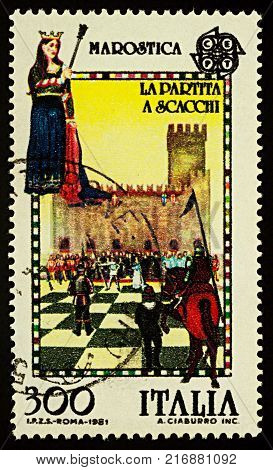 Moscow Russia - December 05 2017: A stamp printed in Italy shows human chess game with real people in Marostica city in northern Italy series