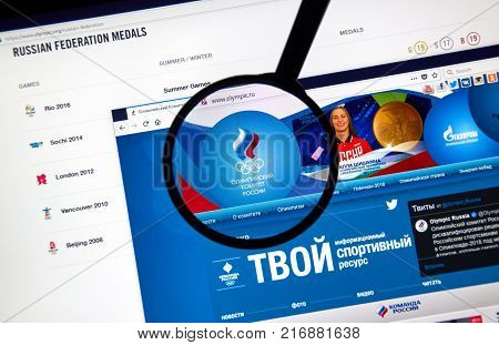MONTREAL CANADA - DECEMBER 5 2017: Russian Olympic Committee web page under magnifying glass.