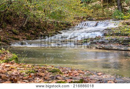 Water over a cascading waterfall in rural Kentucky.