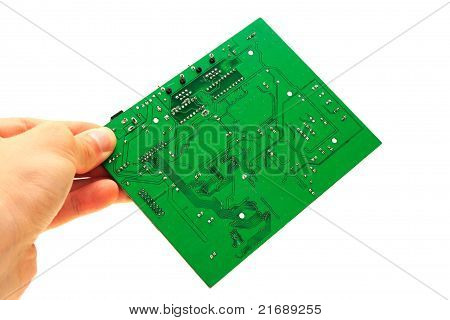 Human Hand Holding Green Computer Circuit Board