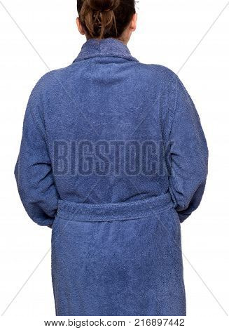 Young woman wearing blue cotton velour bathrobe isolated on white background