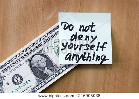On a paper dollar note in anything not deny yourself