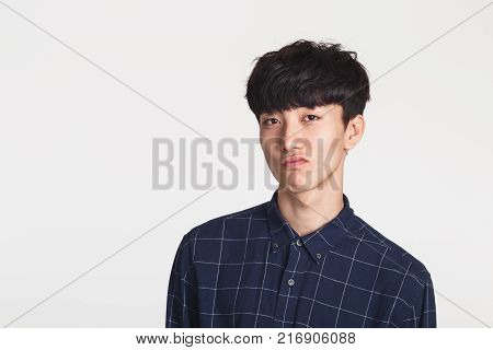 Studio portrait of a playful Asian young man