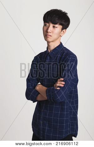 Studio portrait of an Asian young man with disappointment at something