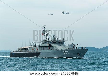 Pattaya Thailand - November 9 2017 Navy warships running on sea while warplanes flying above warships on the 50th anniversary ASEAN international fleet 2017 review drill in Pattaya Thailand