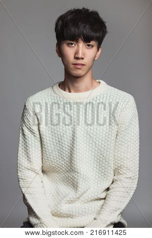 Studio portrait of an asian man with an expressionless look