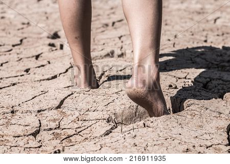 The feet that walk on the ground break because of drought Concept drought.