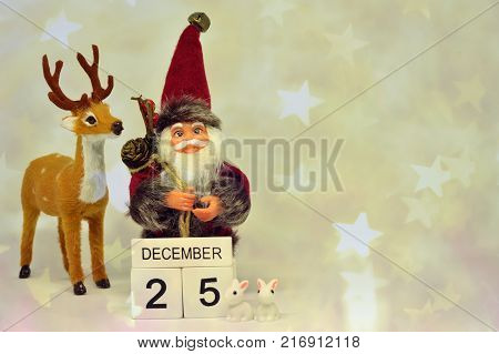 Double exposure handsome Santa Claus cute brown deer and white tiny rabbits with wood block calendar on twenty-fifth December on red,yellow glitter star bokeh background,Concept for Christmas.