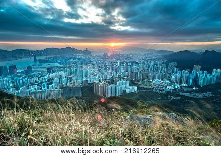 KOWLOON PEAK, HONG KONG - DEC 18, 2013 - Sunset over Hong Kong as seen from Kowloon Peak. Also known as Fei Ngo Shan, Kowloon Peak is the 18th tallest mountain in Hong Kong.
