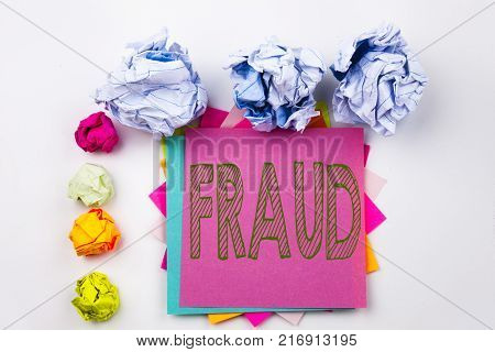 Writing text showing Fraud written on sticky note in office with screw paper balls. Business concept for Fraud Crime Business Scam on white isolated background.