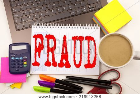 Writing word Fraud text in the office with surroundings such as marker, pen writing on calculator. Business concept for Fraud Crime Business Scam white background with space