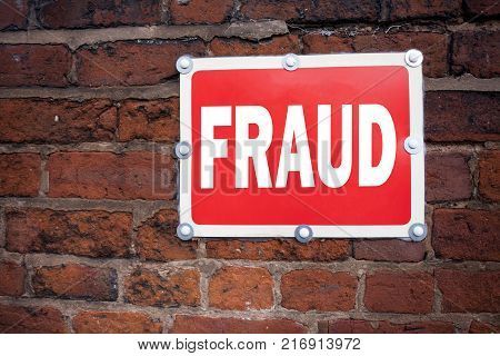 Hand writing text caption inspiration showing Fraud concept meaning Fraud Crime Business Scam written on old announcement road sign with background and space