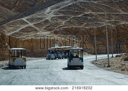 Luxor, Egypt - November 13, 2006: Some busses on the way to the Valley of the Kings in Egypt