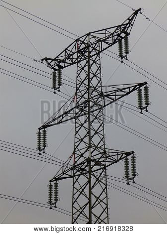 An electric power grid towering over the sky, a transmission tower