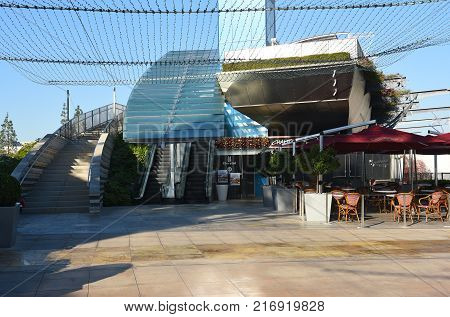 COSTA MESA CA - DEC 1 2017: Champagne French Bakery Cafe South Coast Plaza and the stairs leading to the Bridge of Gardens pedestrian walkway connecting the two side of the mall.