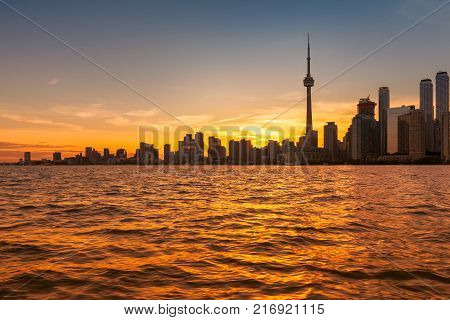 The beautiful Toronto skyline with CN Tower over lake. Canada.