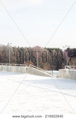 winter landscape. Street, stairs, roll, trees and snow background. Vertical photo