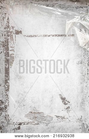 Grungy frame with remains of scotch tape and cellophane. Vertical background fully editable.