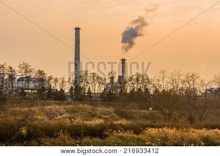 Column Of Smoke Rising From Tall White Smokestack