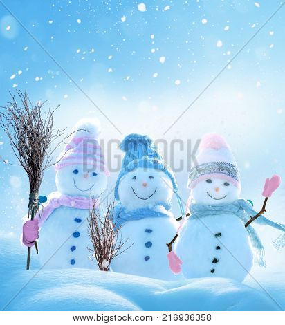 Merry Christmas and happy New Year greeting card with copy-space.Many snowmen standing in winter Christmas landscape.Winter background