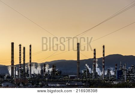 Factory Smoke stack. Petrochemical plant, Oil and gas refinery at twilight