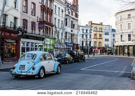Cork, Ireland - November 12, 2017: St Patrick Street in Cork. It is the main shopping street in the city
