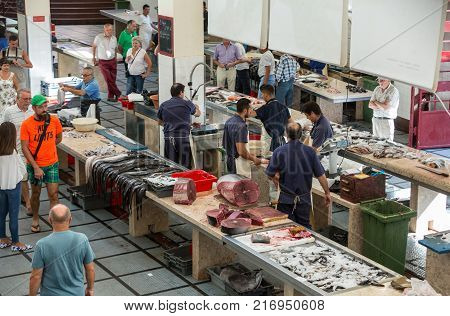 FUNCHAL PORTUGAL - SEPTEMBER 2 2016: Fish sellers at Mercado dos Lavradores the famous fish and seafood market of Funchal the capital of Madeira island