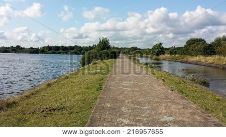 The long straight cobbled pathway between Scotsmans Flash and the Leeds Liverpool canal just outside Wigan