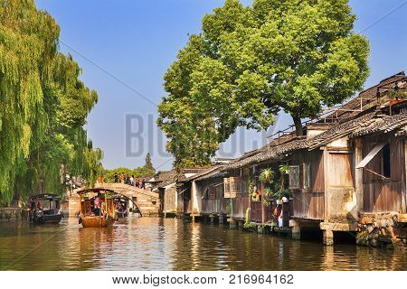 Wuzhen, China - June 24, 2016: Wuzhen a famous scenic historic water town in China. Wuzhen is part of Tongxiang, located in northern Zhejiang Province, China.
