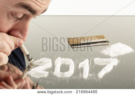 Conceptual photo of man uses cocaine in the form of the number of 2017. Drugs are dangerous to health and illegal in many countries.