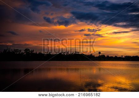 Lanscape lake view park and twilight sunset in the evening time and cloudy sky