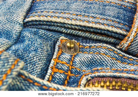 closeup of buckles, clasps, zippers, pockets, fasteners, fittings and seams on the jeans hand bag